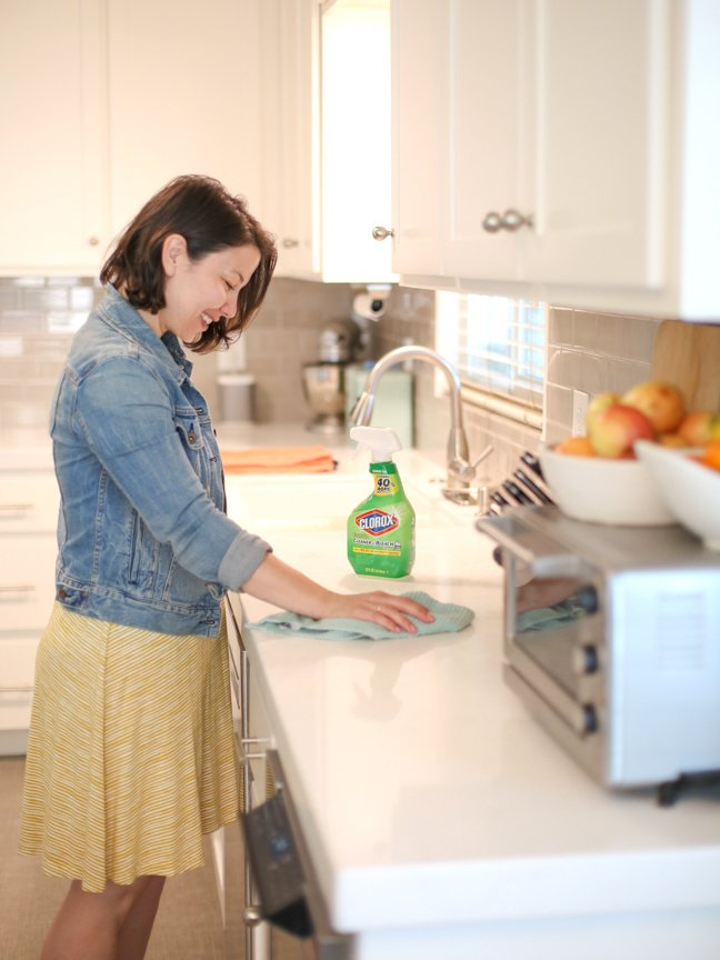 woman-cleaning-kitchen-counter
