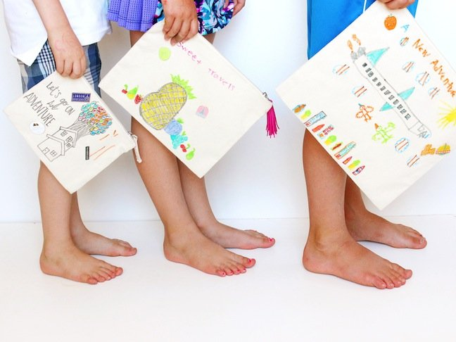 kids-feet-and-hands-holding-bags