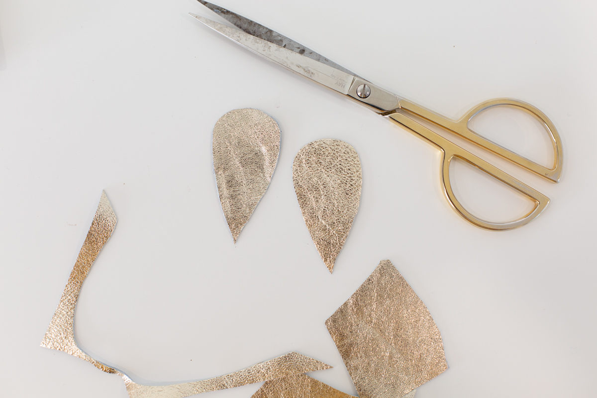Gold leather cutouts with scissors