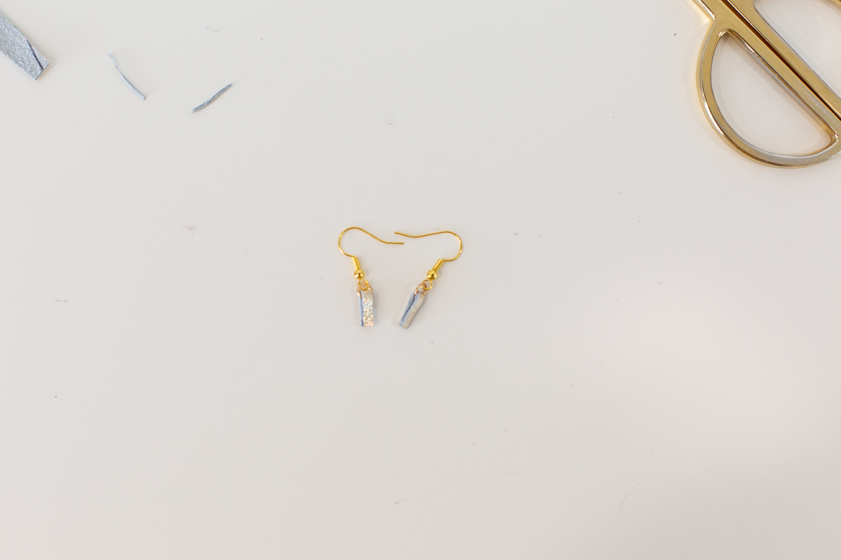Fish hook earring backs with gold leather strips